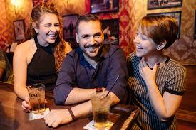 bar man with 2 ladies