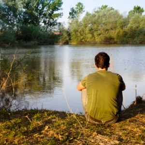 man thinking at lake